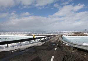 Single lane wooden bridge over geothermal pools